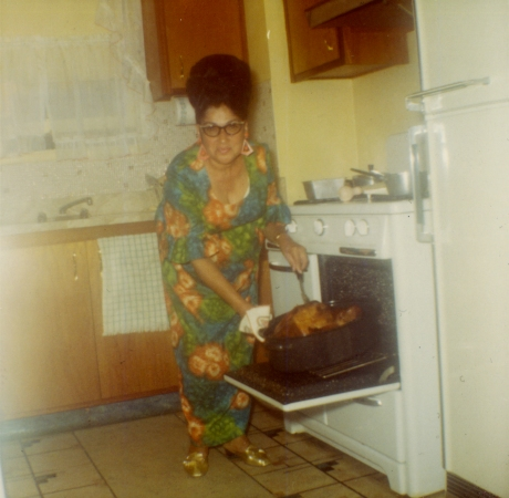 Grandma basting the holiday turkey.