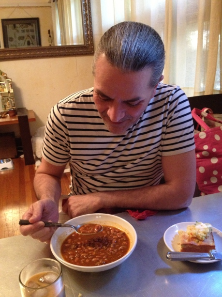Mr. David enjoying my grandmothers chili beans.