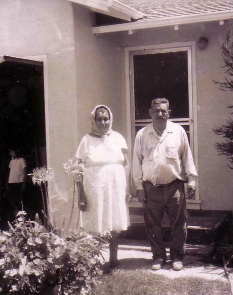 I love this picture of my grandparents in front of their home.